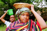 Pupils from Archbishop Sunner School in Kennington, london UK Wearing African dress and carrying water/food<br />
