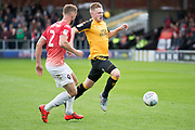 Cambridge United forward George Maris tackled by Salford City defender Scott Wiseman during the EFL Sky Bet League 2 match between Salford City and Cambridge United at Moor Lane, Salford, United Kingdom on 12 October 2019.