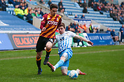 Bradford City midfielder, on loan from Newcastle United, Alex Gilliead (18) skips past Coventry City defender Chris Stokes (3)  during the EFL Sky Bet League 1 match between Coventry City and Bradford City at the Ricoh Arena, Coventry, England on 11 March 2017. Photo by Simon Davies.