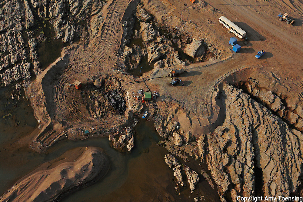ORANJEMUND, NAMIBIA -- OCTOBER 06: Aerial views of the shipwreck site in the Namdeb diamond mine on October 06, 2008 in Oranjemund, Namibia. The wreck was discovered by miners in the Namdeb diamond mine off the coast of Namibia. The ship was found seven meters below sea level on April 1, 2008. Archeologists presume the wreck is from the early 1500s. Most of the the artifacts found are being stored in a storage shed at the Namdeb Diamond Mine. Items include: copper ingots, bronze canons, canon balls, pewter bowls and plates, ivory tusks from African elephants, and most substantial over 2000 gold coins- approximately 21 kg - the most gold found in Africa since the Valley of the Kings in Egypt. (Photo by Amy Toensing) _________________________________<br /> <br /> For stock or print inquires, please email us at studio@moyer-toensing.com.