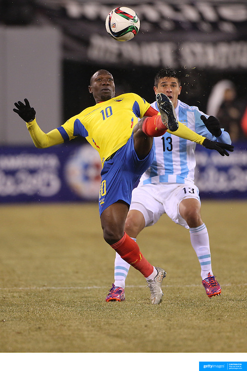 Walter Ayovi, Ecuador, clears while challenged by Facundo Roncaglia, Argentina, during the Argentina Vs Ecuador International friendly football match at MetLife Stadium, New Jersey. USA. 31st march 2015. Photo Tim Clayton