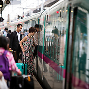 TOKYO, JAPAN - JULY 13 : A passengers in a platform rides a bullet train at Tokyo Station on Wednesday, July 13, 2016, Tokyo, Japan.<br />   <br /> Photo: Richard Atrero de Guzman