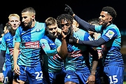 The Wycombe Wanderers players  scores a goal and celebrates  Wycombe Wanderers defender Anthony Stewart (5) (sucking thumb)  goal 1-0 during the The FA Cup match between Wycombe Wanderers and Tranmere Rovers at Adams Park, High Wycombe, England on 20 November 2019.