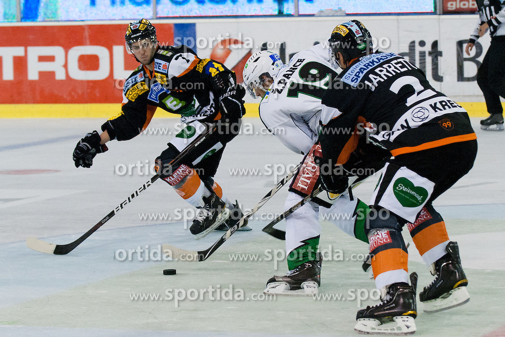 Ziga Pance (HDD Tilia Olimpija, #19) vs Rodney Coleman Jarrett (Moser Medical Graz 99ers, #2) during ice-hockey match between HDD Tilia Olimpija and Moser Medical Graz 99ers in 2nd Round of EBEL league, on September 11, 2011 at Hala Tivoli, Ljubljana, Slovenia. (Photo By Matic Klansek Velej / Sportida)