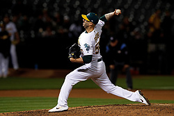 OAKLAND, CA - MAY 07: Mike Fiers #50 of the Oakland Athletics pitches against the Cincinnati Reds during the ninth inning at the Oakland Coliseum on May 7, 2019 in Oakland, California. The Oakland Athletics defeated the Cincinnati Reds 2-0. (Photo by Jason O. Watson/Getty Images) *** Local Caption *** Mike Fiers