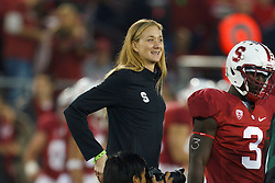 Nov 12, 2011; Stanford CA, USA;  Stanford Cardinal former volleyball player Kerri Walsh serves as an honorary captain for the coin toss before the game against the Oregon Ducks at Stanford Stadium.  Oregon defeated Stanford 53-30. Mandatory Credit: Jason O. Watson-US PRESSWIRE