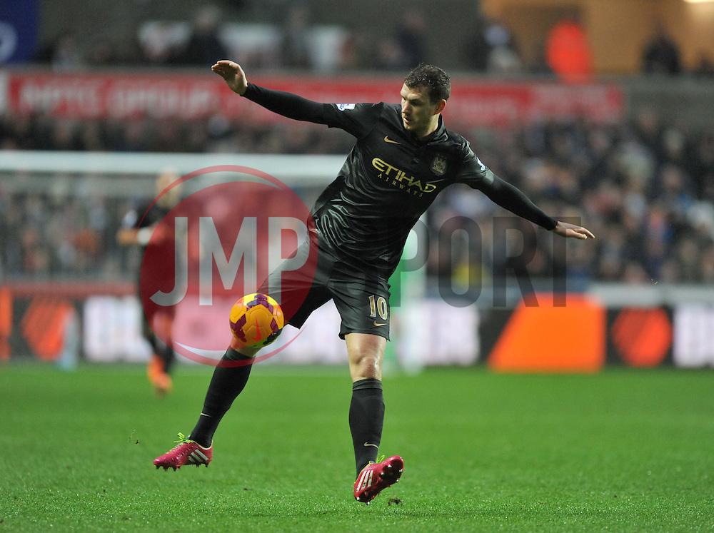 Manchester City's Edin Džeko in action during the second half. - Photo mandatory by-line: Alex James/JMP - Tel: Mobile: 07966 386802 01/01/2014 - SPORT - FOOTBALL - Liberty Stadium - Swansea - Swansea City v Manchester City - Barclays Premier League
