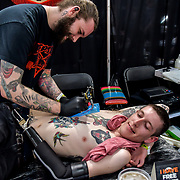 Willies! Tattoos, Tattoo a client at The Great British Tattoo Show, on 26 May 2019, London, UK.