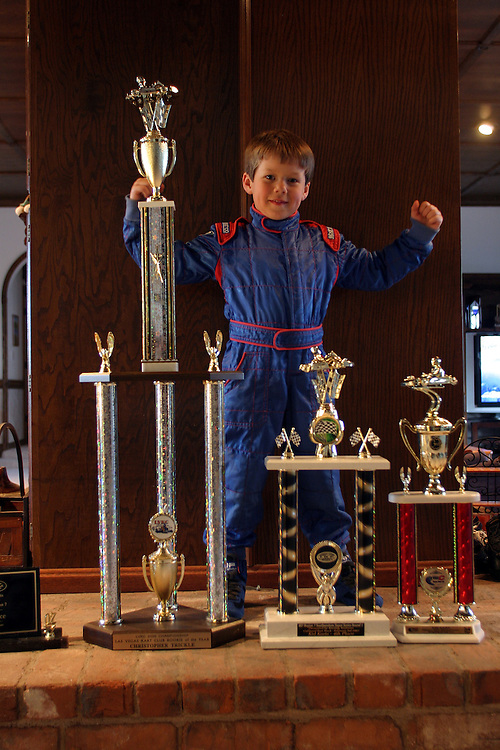 Chris trickle 6 in his home at Las Vegas Nevada  with a big trophies that he wiener in a go kart race. Tursday March 1.2007......Chris  is a professional go kart race driver...He weans few competitions in Nevada and California...He rise up in a family that in the NASCAR drivers his grandfather was a NASCAR driver and his ankle is a champion of NASCAR drivers...His dream is to drive a NASCAR car that belongs to his uncle that he name after and got killed in Las Vegas. ..