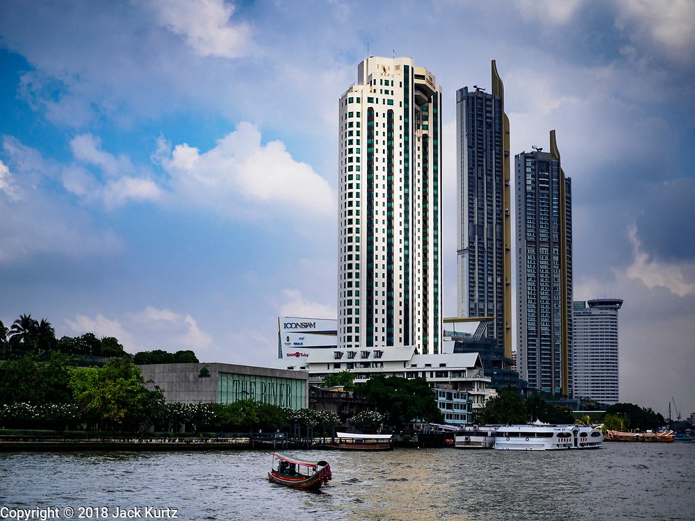 17 NOVEMBER 2018 - BANGKOK, THAILAND: Looking north up the Chao Phraya River with the new ICONSIAM development on the right. ICONSIAM is a mixed-use development on the Thonburi side of the Chao Phraya River. It includes two large malls, with more than 520,000 square meters of retail space, an amusement park, two residential towers and a riverside park. It is the first large scale high end development on the Thonburi side of the river and will feature the first Apple Store in Thailand and the first Takashimaya department store in Thailand.      PHOTO BY JACK KURTZ