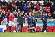 Nottingham Forest manager Martin O'Niell tends to the injured Nottingham Forest's Pele (28)  during the EFL Sky Bet Championship match between Nottingham Forest and Blackburn Rovers at the City Ground, Nottingham, England on 13 April 2019.