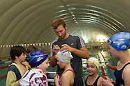 """Swimmer Ian THORPE (C) of Australia is doing autographs at the temporary covered 50m outdoor pool at the Centro sportivo nazionale della gioventu (""""youth and sports""""-Centre) in Tenero, Switzerland, Wednesday, March 16, 2011. Five-time Olympic gold medallist Ian Thorpe has finalised his coaching set-up ahead of next year's London Olympic Games, announcing today that he will link up with former Australian Institute of Sport Coach and Russian born Gennadi Touretski in Switzerland. (Photo by Patrick B. Kraemer / MAGICPBK)"""