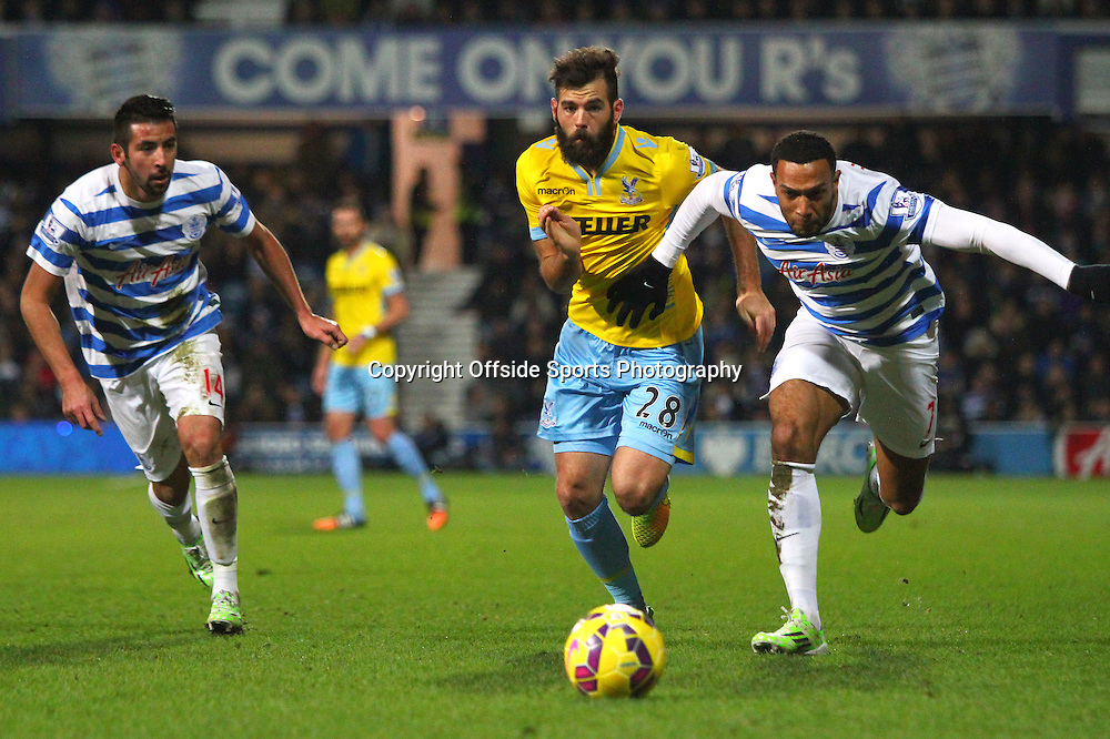 28 December 2014. Premiership. Queens Park Rangers v Crystal Palace.<br /> QPR midfielder Matt Phillips looks determined as both he and Joe Ledley of Palace chase the ball.<br /> Photo: Charlotte Wilson