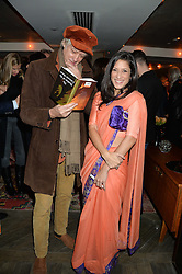 SIR BOB GELDOF and FATIMA BHUTTO at a reception to celebrate the publication of The Shadow of The Crescent Moon by Fatima Bhutto at the Belgraves Hotel, 20 Chesham Place, London, on 2nd December 2013.