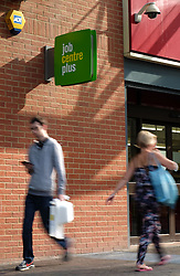 © Licensed to London News Pictures. 14/09/2016. Portsmouth, UK.  People walking past the Job Centre Plus in Portsmouth this morning following the latest unemployment figures showing that the rate remains unchanged at 4.9% following Brexit. The number of people unemployed fell by 190,000 from the previous year, while the number of people in employment rose 174,000, taking the total to 31.77 million. Photo credit: Rob Arnold/LNP