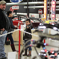 Adam Robison | BUY AT PHOTOS.DJOURNAL.COM<br /> Carlo Tadlock, 6, and his dad, of Byhalia, look at the dragsters exhibit as they walk through the Tupelo Automobile Museum on Monday. The exhibit runs through March 4. Antique Tractors and Farm Equipment will be next months exhibit and will start the March 5.
