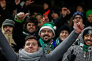 Sporting Clube de Portugal fans, one wearing a green Santa Hat before the UEFA Champions League match at Stamford Bridge, London<br /> Picture by David Horn/Focus Images Ltd +44 7545 970036<br /> 10/12/2014