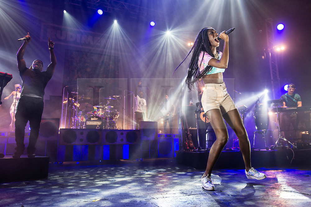 © Licensed to London News Pictures. 15/02/2014. London, UK.   Rudimental performing live at Brixton Academy. In this picture - DJ Locksmith (left), Bridgette Amofah (right).  Rudimental are an English electronic music quartet consisting of members Piers Agget,Kesi Dryden, Amir Amor,DJ Locksmith.    Photo credit : Richard Isaac/LNP