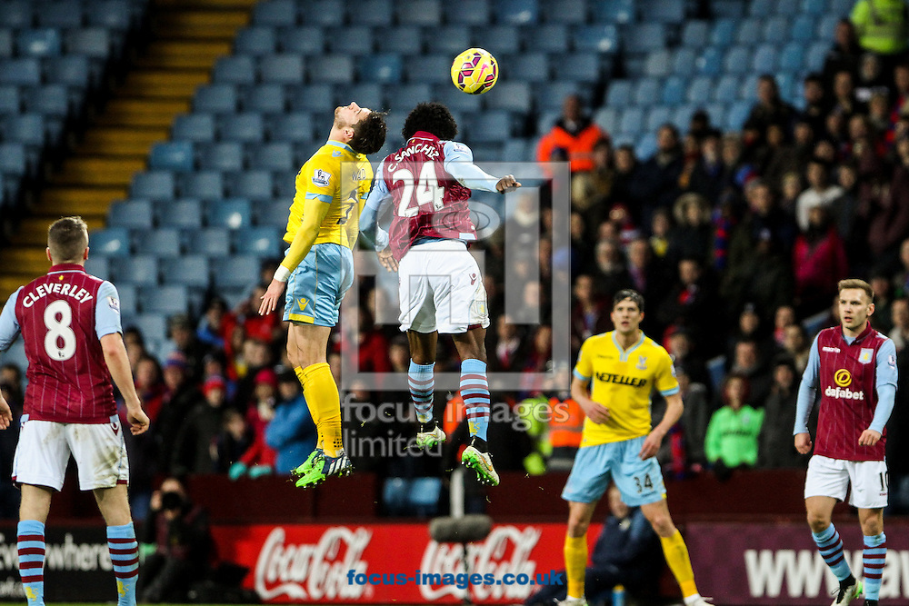Carlos Sanchez of Aston Villa (centre right) heads clear during the Barclays Premier League match at Villa Park, Birmingham<br /> Picture by Andy Kearns/Focus Images Ltd 0781 864 4264<br /> 01/01/2015