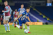 Peter Gwargis (Brighton) with control of the ball with Matt Targett (Aston Villa) looking on during the EFL Cup match between Brighton and Hove Albion and Aston Villa at the American Express Community Stadium, Brighton and Hove, England on 25 September 2019.