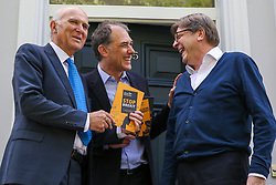 © Licensed to London News Pictures. 10/05/2019. London, UK. Guy Verhofstadt, the EU Parliament's representative on Brexit and the Leader ofthe Alliance of Liberals and Democrats for Europe and Leader of Liberal Democrats, Vince Cable and Marc Vlessing a resident in Camden, north London holds the party manifesto during canvassing for the Liberal Democrats European Union election campaign. Britain must hold European Parliament elections on 23rd May 2019 or leave the European Union with no deal on 1st June 2019 after Brexit was delayed until 31st October 2019, as Prime Minister, Theresa May failed to get her Brexit deal approved by Parliament. Photo credit: Dinendra Haria/LNP