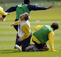 Photo: Chris Ratcliffe.<br />Arsenal Training Session. UEFA Champions League. 18/04/2006.<br />Alexander Hleb screams out in pain after being injured by Cesc Fabregas during training