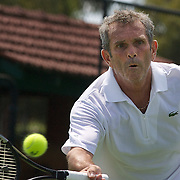 Xavier Lemoine, France, in action against Luis Flor de la Morena, Spain, in the Von Cramm Cup match during the 2009 ITF Super-Seniors World Team and Individual Championships at Perth, Western Australia, between 2-15th November, 2009..