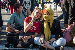 London, UK. 20 September, 2019. Anna Taylor (l), co-founder of UK Student Climate Network, joins students blocking Lambeth Bridge during the second Global Climate Strike in protest against a lack of urgent action by the UK Government to combat the global climate crisis. The Global Climate Strike grew out of the Fridays for Future movement and is organised in the UK by the UK Student Climate Network.