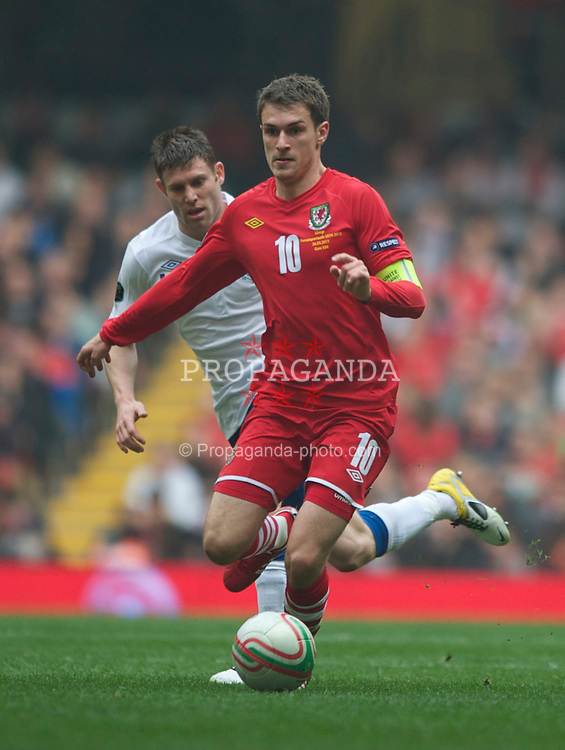 CARDIFF, WALES - Saturday, March 26, 2011: Wales' captain Aaron Ramsey in action against England during the UEFA Euro 2012 qualifying Group G match at the Millennium Stadium. (Photo by Chris Brunskill/Propaganda)