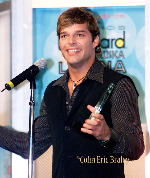 """Latin singer Ricky Martin talks to the media after winning the """"Spirit of Hope Award"""" at the 2002 Latin Billboard Awards show in Miami Beach, Florida May 9, 2002. Martin recieved the award for his work with a medical foundation in Puerto Rico. PHOTO BY: COLIN BRALEY"""