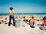 Girl standing on the beach next to a dustbin wearing angel wings and a cowboy hat, Ibiza, 2000
