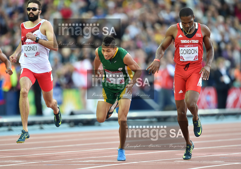 GLASGOW, SCOTLAND - JULY 30: Wayde van Niekerk of South Africa dips at the finish line during the mens 400m final4 on day 7 of the 20th Commonwealth Games at Hampden Park Athletics stadium on July 30, 2014 in Glasgow, Scotland. (Photo by Roger Sedres/ImageSA)