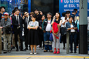 HONG KONG - APRIL 13: A crowd of customers and white-collars wait to cross the street in Central business district, on April 13, in Hong Kong. (Photo by Lucas Schifres/Pictobank)