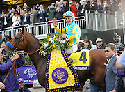 Victor Espinoza smiles after he and American Pharoah won the Breeders' Cup Classic at Keeneland Racecourse on Saturday, Oct. 31, 2015 in Lexington, KY.  Longines, the Swiss watch manufacturer known for its elegant timepieces, is the Official Watch and Timekeeper of the Breeders' Cup World Championships and the Triple Crown. (Photo by Diane Bondareff/Invsion for Longines/AP Images)