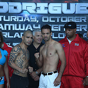 Miguel Cotto of Puerto Rico (left) and Delvin Rodriguez of the Dominican Rebublic square off during the official weigh in for a 12-round super welterweight bout at the Amway Arena in Orlando, Florida on Friday, October 4, 2013.  Cotto (37-4, 30 KOs) a 3-time Champion, recently hired Hall of Fame trainer Freddie Roach for this  televised bout. (AP Photo/Alex Menendez)