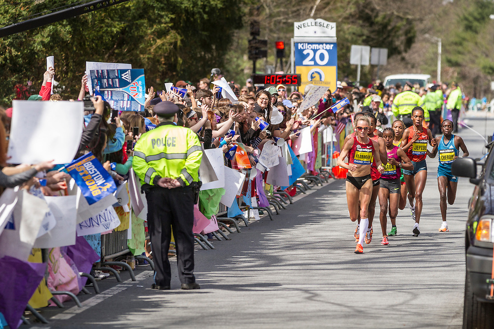 2014 Boston Marathon: spectators and students cheer as the elite women runners pass Wellesley College at mid point of race, led by Shalane Flanagan