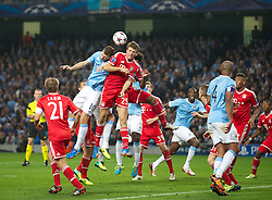 MANCHESTER, ENGLAND - Wednesday, October 2, 2013: Manchester City's Edin Dzeko in action against Bayern Munich's Thomas Muller during the UEFA Champions League Group D match at the City of Manchester Stadium. (Pic by David Rawcliffe/Propaganda)