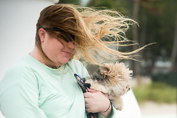 September 9, 2017 - Fort Lauderdale, Florida, U.S - Katie Amanda of Fort Lauderdale visits the beach in Fort Lauderdale with her dog as Hurricane Irma approaches Florida and wind starts to pick up. (Credit Image: © Orit Ben-Ezzer via ZUMA Wire)