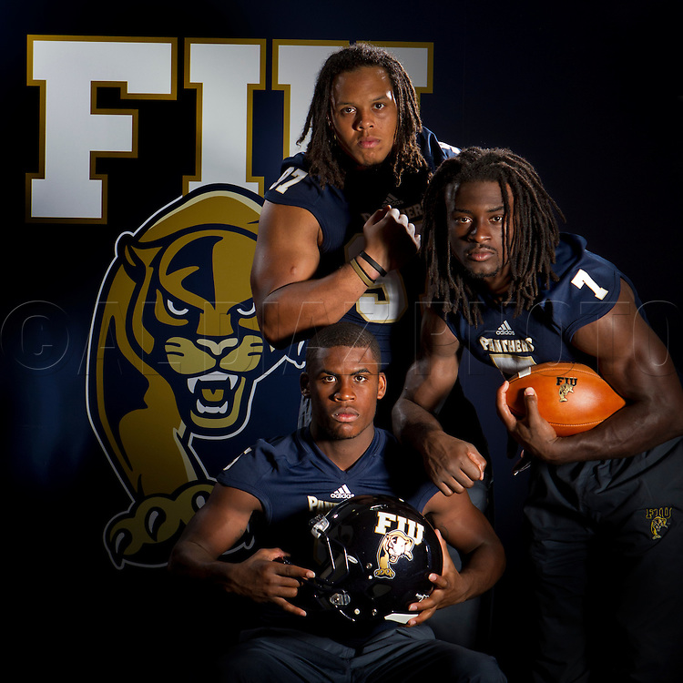 Florida International University football players Wayne Times, (5), Tourek Williams, (97), Johnathan Cyprien, (7), on campus on August 24, 2012 for the Miami Herald's Football Season Preview.