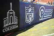 Wall banners sporting the logos of the Los Angeles Memorial Coliseum, the NFL shield, and the Los Angeles Rams decorate the sideline before the Los Angeles Rams 2016 NFL preseason football game against the Dallas Cowboys on Saturday, Aug. 13, 2016 in Los Angeles. The Rams won the game 28-24 while enjoying the largest crowd to watch a preseason football game in United States history with 89,140 fans in attendance. (©Paul Anthony Spinelli)