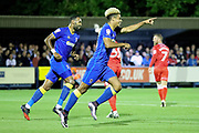 AFC Wimbledon striker Lyle Taylor (33) celebrating after AFC Wimbledon striker Andy Barcham (17) scored goal to make it 1-0  during the EFL Sky Bet League 1 match between AFC Wimbledon and Gillingham at the Cherry Red Records Stadium, Kingston, England on 12 September 2017. Photo by Matthew Redman.