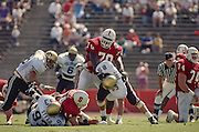 Bob Whitfield, #70, Stanford, Sep 1991 v Colorado. Tommy Vardell in foreground.