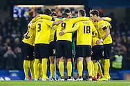 Watford players in a huddle before the FA Cup match against Chelsea at Stamford Bridge, London<br /> Picture by David Horn/Focus Images Ltd +44 7545 970036<br /> 04/01/2015