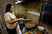 Katherine Navas cooks dinner at home for friday night dinner with extended family, Caracas, Venezuela. (Katherine Navas is featured in the book What I Eat: Around the World in 80 Diets.) MODEL RELEASED.