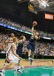 Georgia Tech guard Iasia Hemingway (34) grabs a rebound against UVA.  The #4 seed/#25 ranked Virginia Cavaliers women's basketball team defated the #5 seed Georgia Tech Yellow Jackets 52-43 in the quarterfinals of the 2008 ACC Women's Basketball Tournament at the Greensboro Coliseum in Greensboro, NC on March 7, 2008.