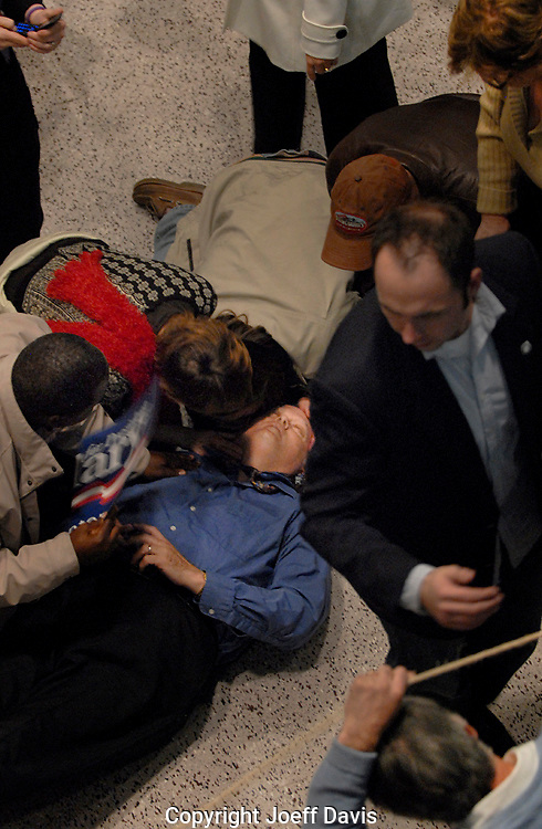 ROCK HILL, South Carolina - January 25, 2008: A man passes out after Hillary Clinton's stump speech in Rock Hill, South Carolina. <br />