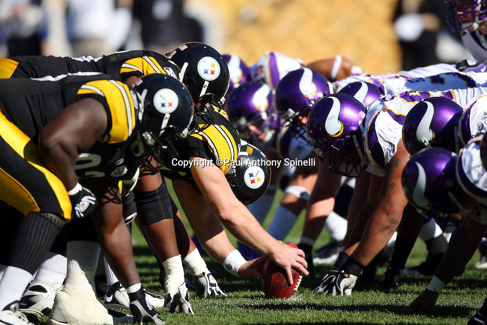 The Pittsburgh Steelers offense gets set to snap the ball at the line of scrimmage during the NFL football game against the Minnesota Vikings, October 25, 2009 in Pittsburgh, Pennsylvania. The Steelers won the game 27-17. (©Paul Anthony Spinelli)
