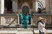 Italy, Siena, the Palio: waiting for the Historic Parade. emergency staff at the chapel just close to the S. Martino Curve