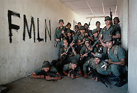 February 1983, El Salvador --- A group of El Salvadoran soldiers poses beside graffiti of their enemy, the FMLN. --- Image by © Owen Franken/CORBIS
