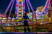 WASHINGTON, USA - September 15: A ride operator waits for the riders to come back around on the roller coaster set up at The Great Frederick Fair in Frederick, Md., USA on September 15, 2017.